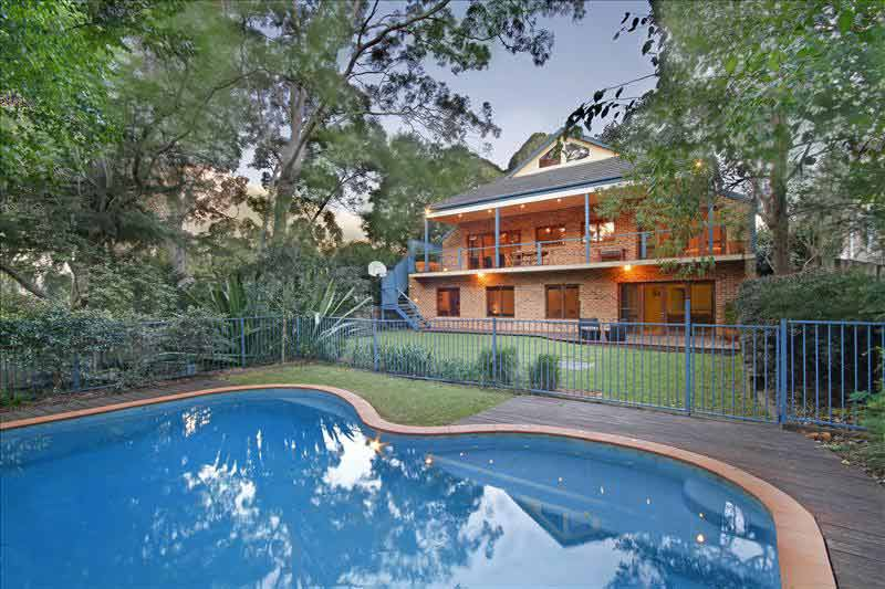 Large home with subtle street presence Killara - swimming pool at night