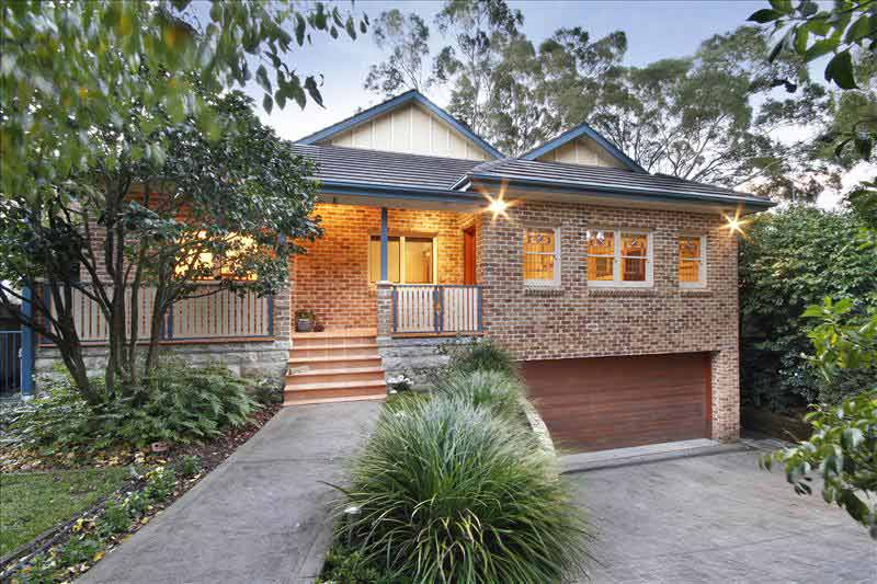 Large home with subtle street presence Killara - front at night