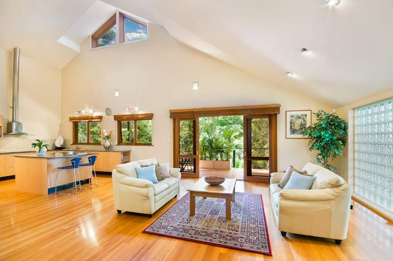 Large home with subtle street presence Killara - skylit living room and kitchen
