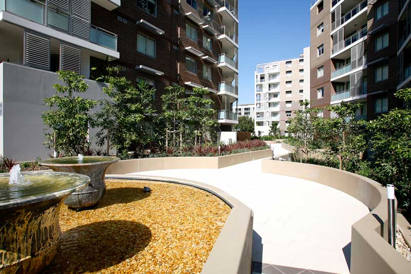 Rina apartment buildings Mascot - walkway