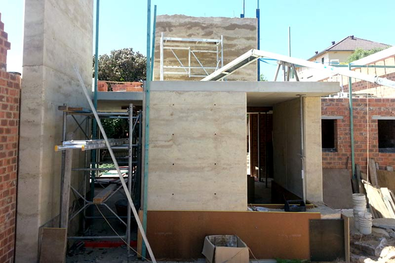 Rammed earth walls take shape as feature in new Coogee house