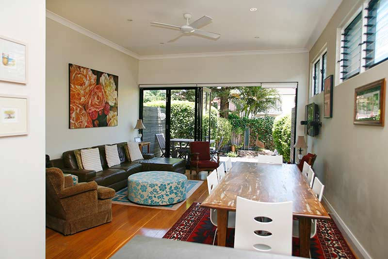 Vibrant Clovelly semi - living room looking to garden
