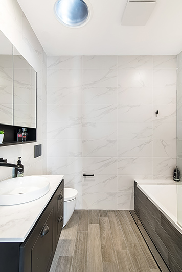Modest exterior expansive interior Maroubra addition - bathroom