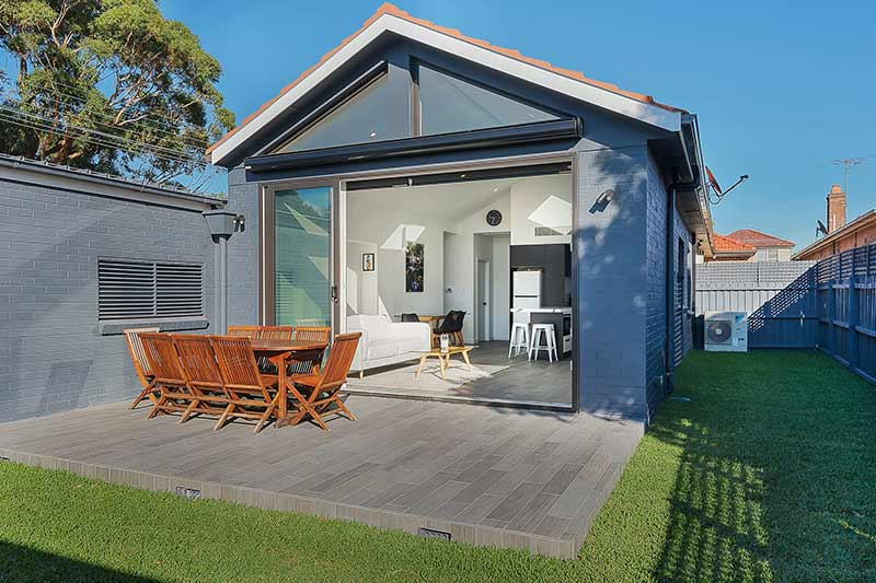 Modest exterior expansive interior Maroubra addition - courtyard looking in to living area
