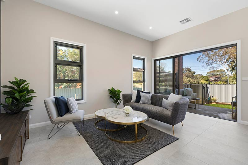 Leafy creekside large family townhouses Gymea - living to courtyard