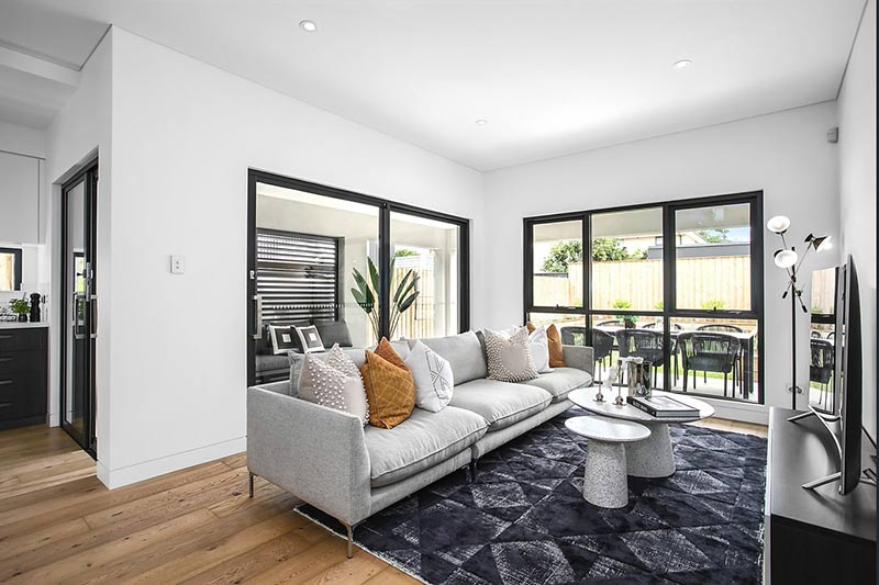 Northern lights Maroubra duplex - living room looking out to outdoors entertainment area