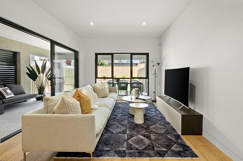 Northern lights Maroubra duplex - long couch living room
