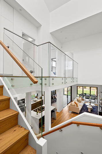 Northern lights Maroubra duplex - stairway, upstairs balustrade and downstairs living area